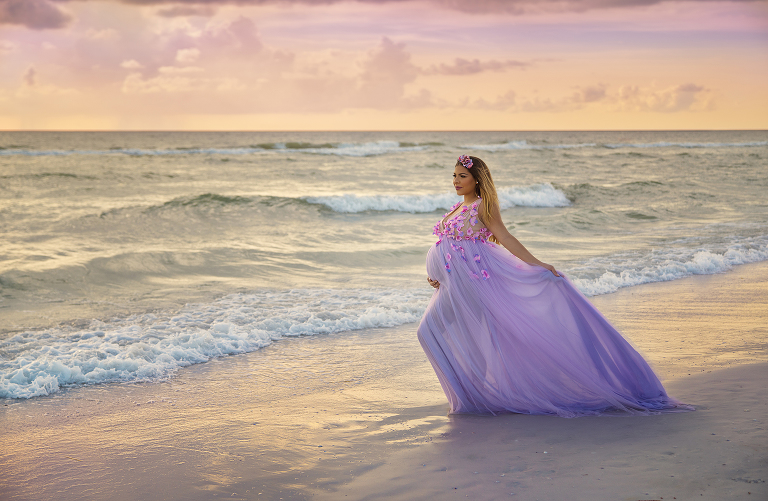 woman in flowing gown on beach