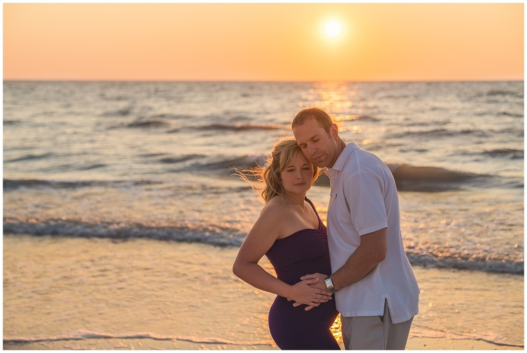 Clearwater beach maternity photos couple
