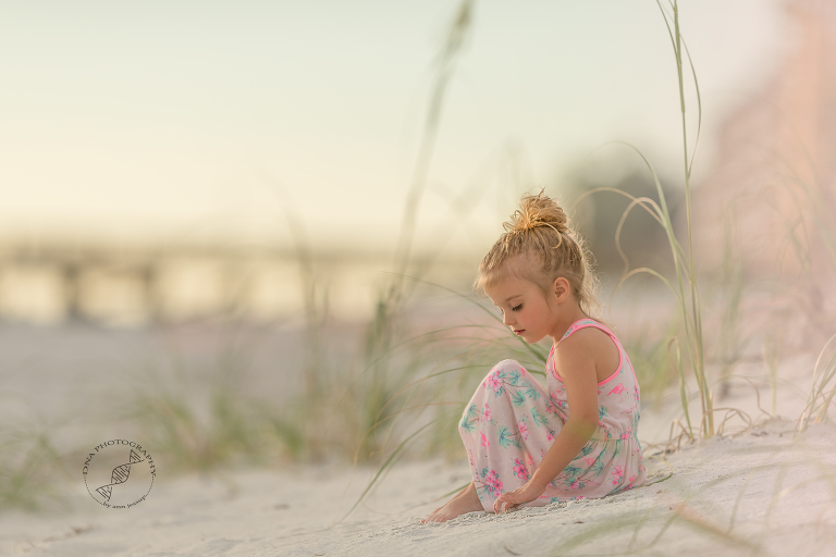 Girl in dunes on beach